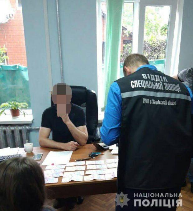 Начальник службы юстиции в Харьковской области получил взятку в две тысячи долларов